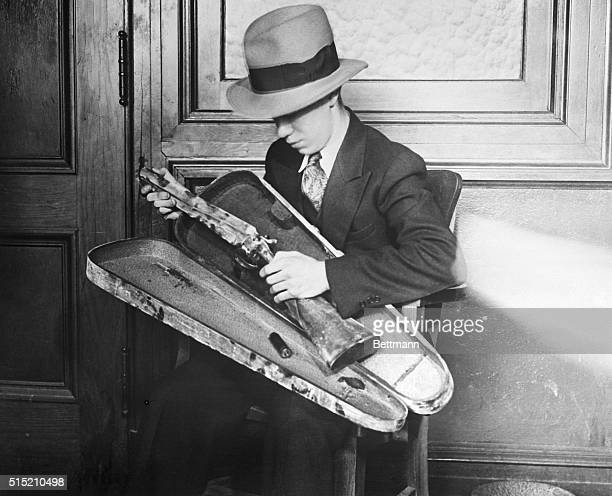 This sawed-off shotgun was carried in a violin case to the Port Newark National Bank in Newark, NJ, 2/28/1930. Three gunmen- determined to seize...