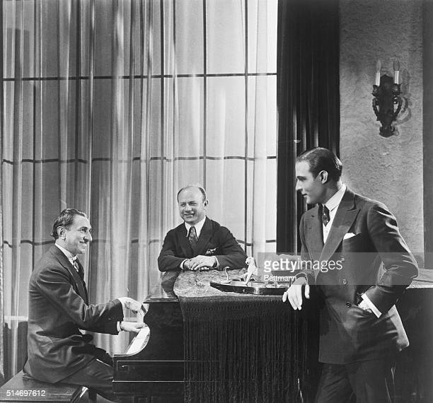 2/28/25Los Angeles California Rudolph Valentino at his Hollywood home Mischa Elman center famous violinist and Rudolph Friml the noted composer of...