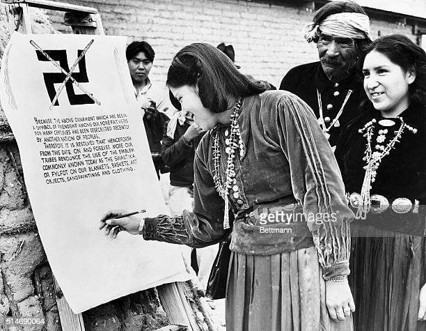 2/28/40Tucson Arizona Florence Smiley and Evelyn Yathe Navajos of Tucson Arizona are shown signing the imposing parchment document which formally...