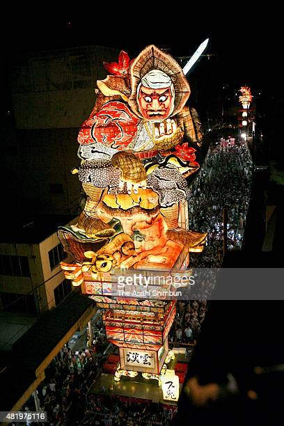 A 22metertall illuminated float called 'Tachineputa' march on during the Tachineputa Festival on August 4 2010 in Goshogwara Aomori Japan
