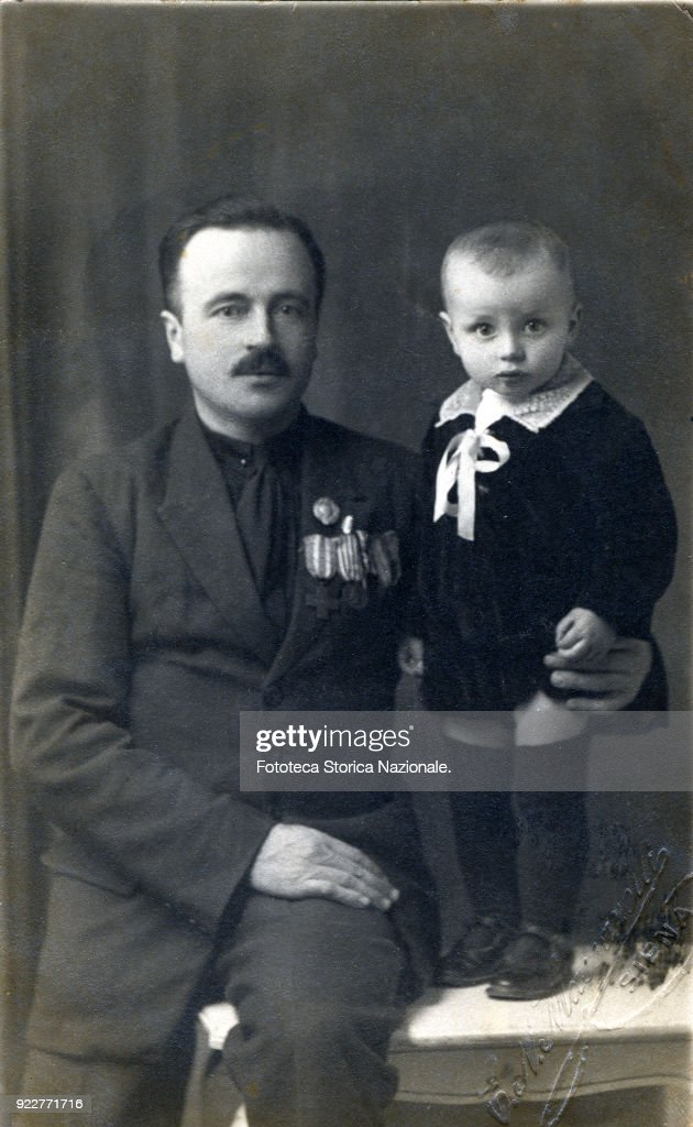 22-month-old child with his father, a highly decorated soldier; manuscript notes on the back: 'Siena, November 1922, 22 months'. Photograph, Italy, Siena 1922.