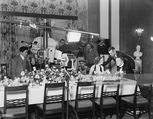 W S Van Dyke directs actors Myrna Loy and William Powell in the crime comedy 'The Thin Man'