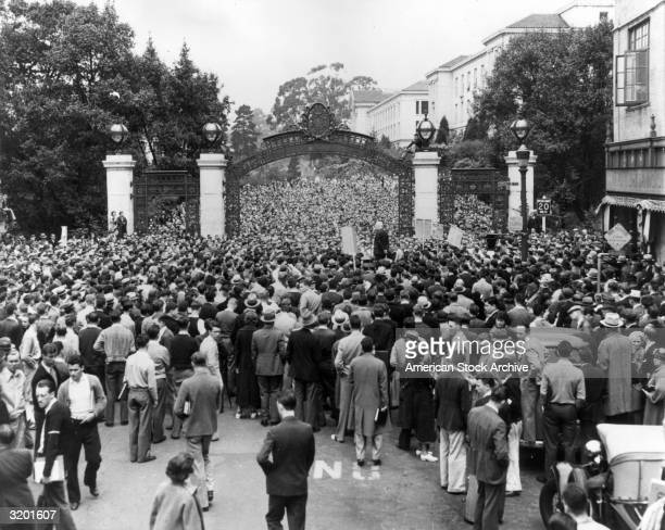 Masses of people crowd through Sather Gate to hear American political activist Norman Thomas's antiwar address on the campus of the University of...
