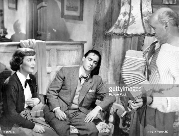 Richard Todd playing a murder suspect finds sanctuary with Jane Wyman and Alastair Sim in the film 'Stage Fright' directed by Alfred Hitchcock Sim...