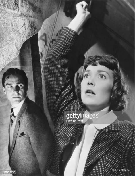 US actress Jane Wyman and Irish actor Richard Todd in a scene from the film 'Stage Fright' directed by Alfred Hitchcock Original Publication Picture...