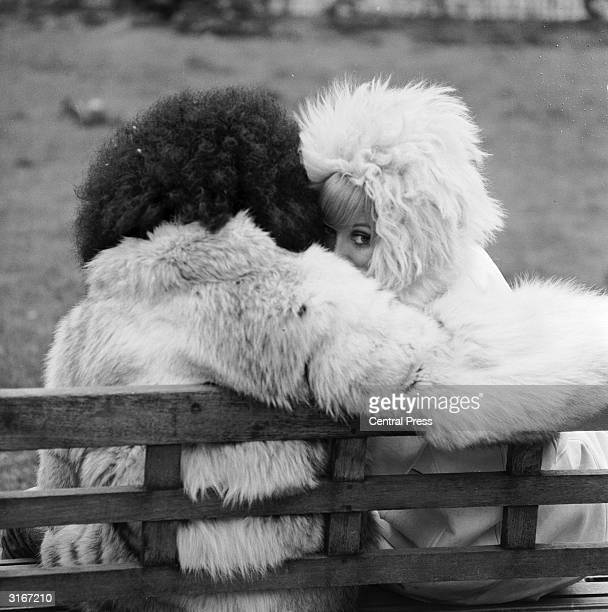 Jimmy Tobing and Sue Marshall model the latest coats from the 'London Fur Fashion Export Group' in Hanover Square London