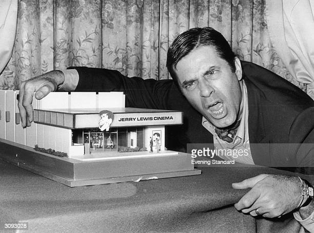 American comedian and film star Jerry Lewis with a model of the 'Jerry Lewis Cinema'