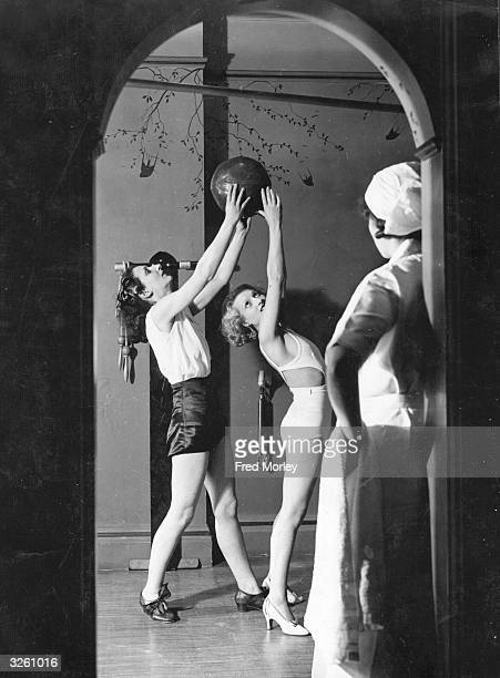 The classical dancer and body culture expert Rosemary Andree instructing one of her pupils in an exercise designed to give graceful movement She is...
