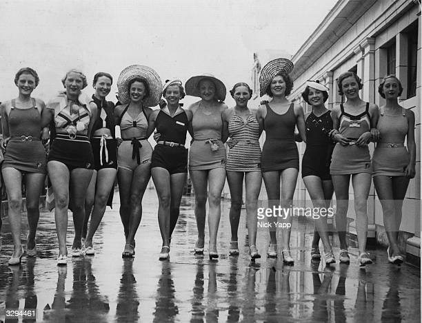 A parade of ladies sport a selection of swimming costumes at the open air pool in Blackpool
