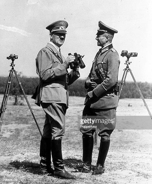 22nd August 1938 Grossborn Germany German Chancellor and Nazi dictator Adolf Hitler watches troop manoeuvres with General Von Brauchitsch...