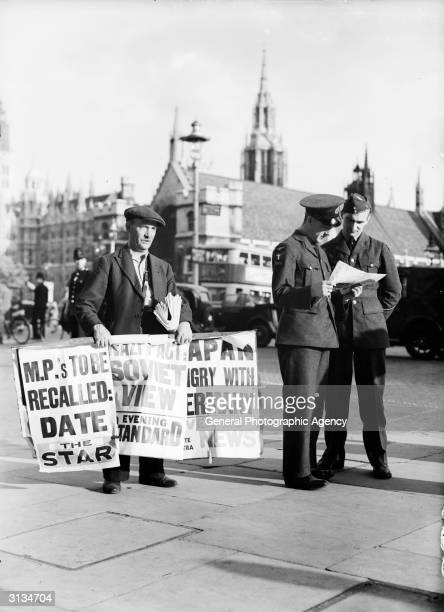Newspaper sellers in Parliament Square publicise the news of a non-aggression pact between Nazi Germany and the USSR.