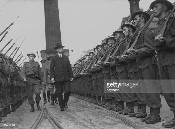 First Taoiseach of the Republic of Ireland Eamon de Valera inspects a guard of honour at O'Connell street in Dublin prior to a parade of local...