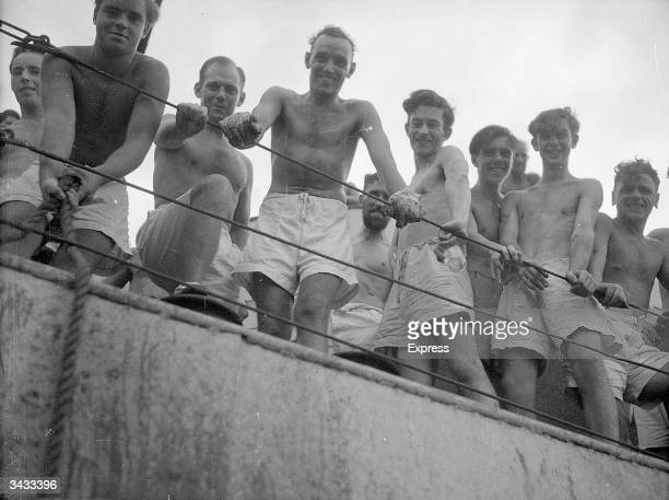 Crew of HMS Amethyst welcoming the mail boat from HMS Jamaica