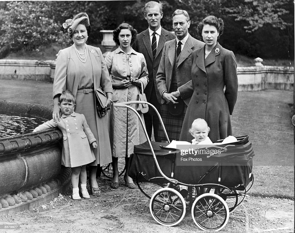 The Royal Family during a visit to Balmoral Castle: (left to right) Queen Elizabeth, Princess Margaret Rose (1930 - 2002), Prince Philip, Duke of Edinburgh, King George VI (1895 - 1952), and Princess Elizabeth with her children Prince Charles (left) and Princess Anne. Queen Victoria's husband, Prince Albert, purchased Balmoral Castle in 1846, and the small castle which stood in the 7,000 hectare wooded estate was redeveloped in the 1850s.The granite building was designed by Aberdeen architect William Smith with suggestions from Albert himself, who decided the interior decoration should represent a Highland shooting box with tartan or thistle chintzes, and walls decorated with trophies and weapons. Queen Victoria often visited the Highlands with her family, especially after Albertfs death in 1861, and Balmoral is still a popular retreat for the present royal family.