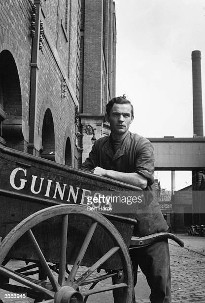 Eugene Hackett a worker at the Guinness brewery on the banks of the Liffey at St James' Gate Dublin leaning on a barrow which is used to take malt...