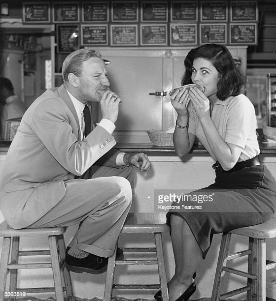 British actors Leslie Phillips and Theona Bryant enjoy a hot dog in Hollywood California