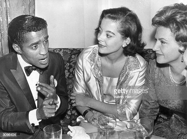 Singer and comedian Sammy Davis Jnr with Birgit Kroencke the wife of actor Christopher Lee