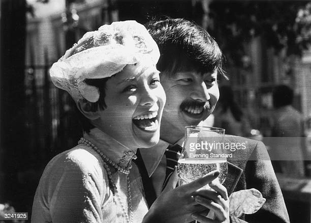 Restauranteur Michael Chow with his new wife American model Bettina Lutz after marrying at Chelsea register office in London