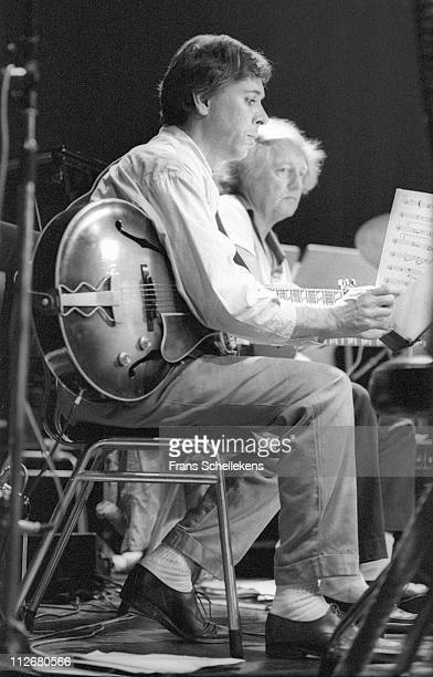 22nd AUGUST: Guitar player Eef Albers with Wim Overgauw behind, performing during the NOS Jazz festival at Meervaart in Amsterdam, Netherlands on...