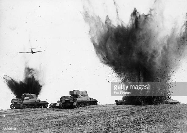 Canadian tanks stage a battle under the watchful eye of Mustang aircraft