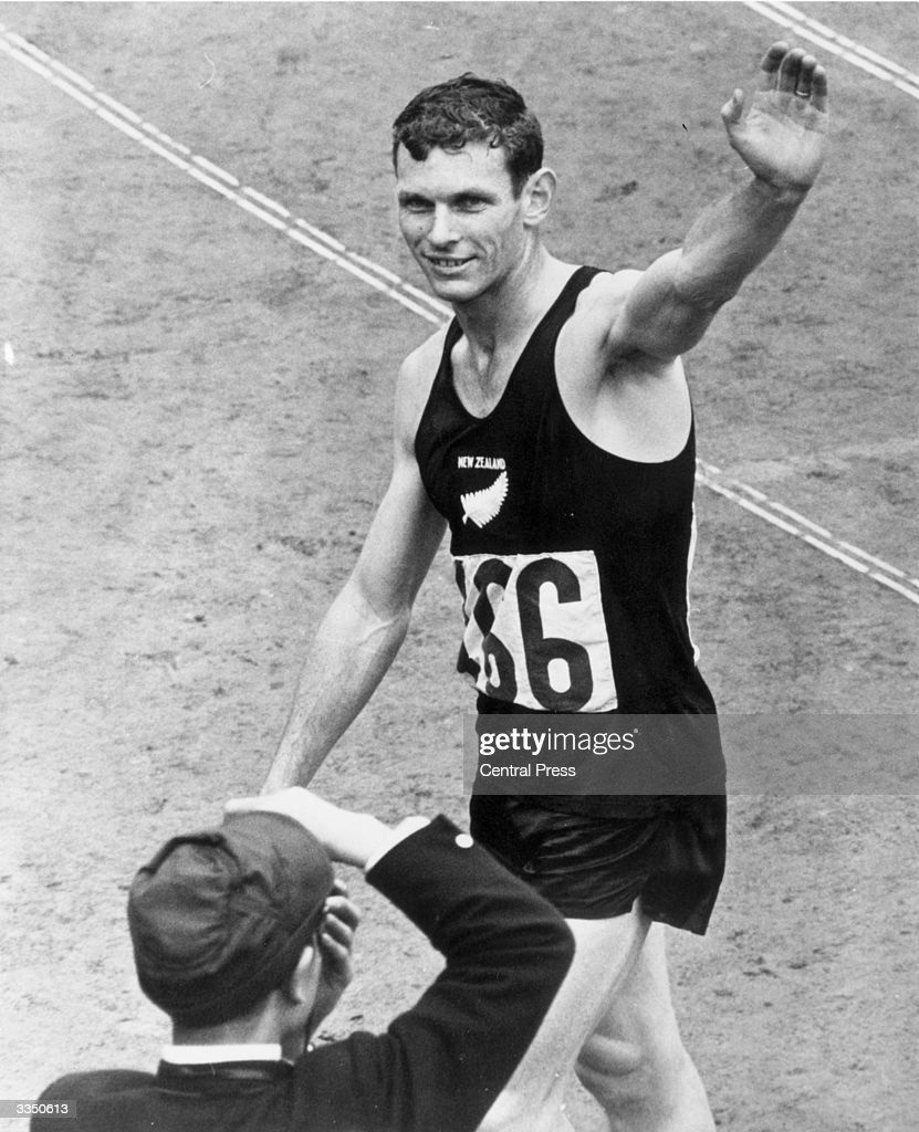Peter Snell of New Zealand acknowledges the applause after winning the gold medal in the 1,500 metres at the Olympic games held in Tokyo. His time was 3 mins 38.1 seconds.