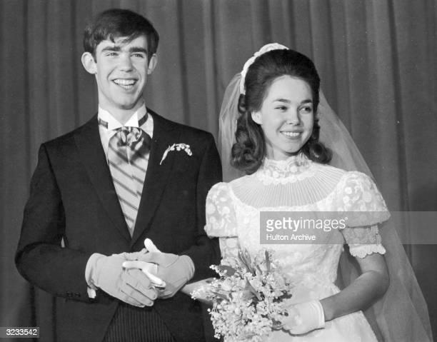 Newlyweds Julie Nixon daughter of President Richard Nixon and David Eisenhower grandson of former President Dwight Eisenhower smile together on their...