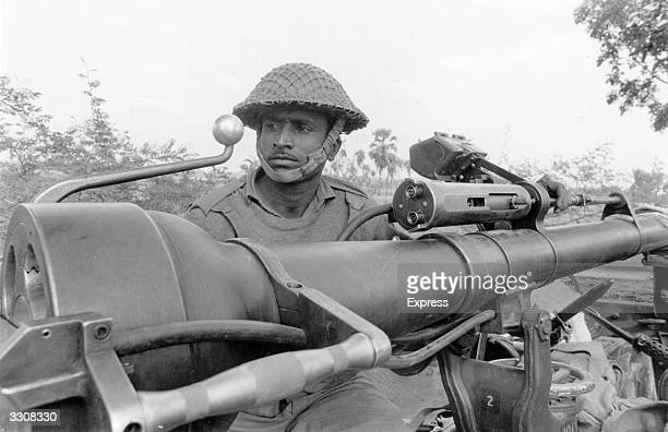 A soldier in action during East Pakistan's struggle to become the independent state of Bangladesh