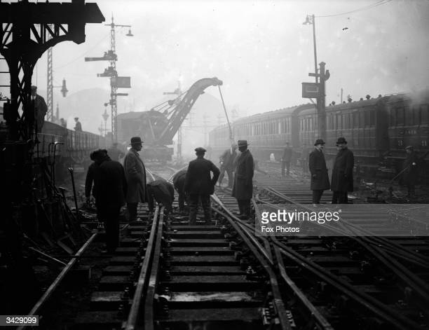 Workmen laying the new rails at King's Cross Station London