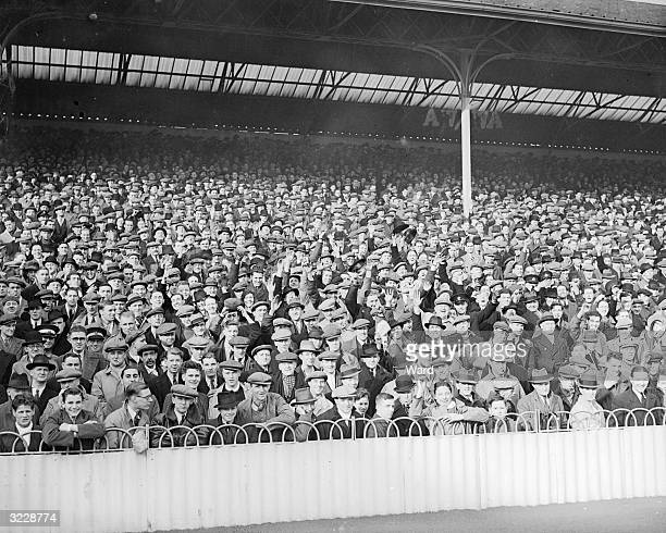 Thousands of fans flock to White Hart Lane to watch the Cup replay match between Tottenham Hotspur and Everton