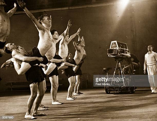 A group of young men trained gymnasts from the Carnegie Institute Leeds taking part in a short instructional and propaganda film being made by the...