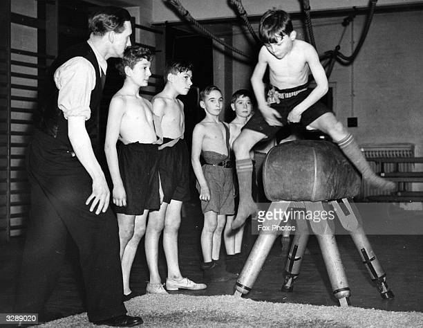 Boys of Avenue School in south London during a physical training class in the school gymnasium