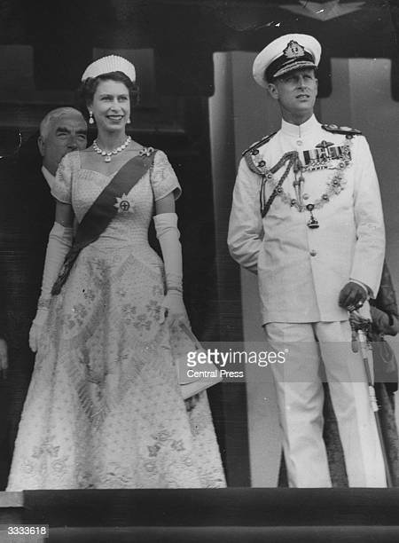 Queen Elizabeth II in her coronation gown and Prince Philip Duke of Edinburgh in his admiral's summer uniform outside Parliament House Canberra after...