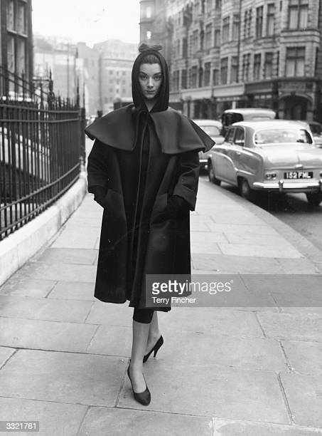 Fashion model wearing a dress and coat by Balenciaga during rehearsals for an appearance on the television show 'Fashions From Paris'.