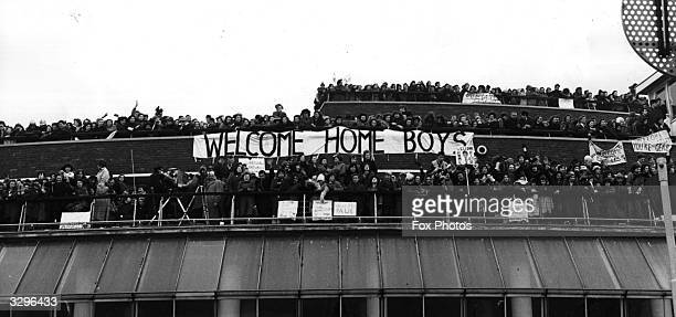 Crowds of Beatles fans gathered on the roof of the Queen's Building at London Airport to welcome their idols back from their tour of the USA