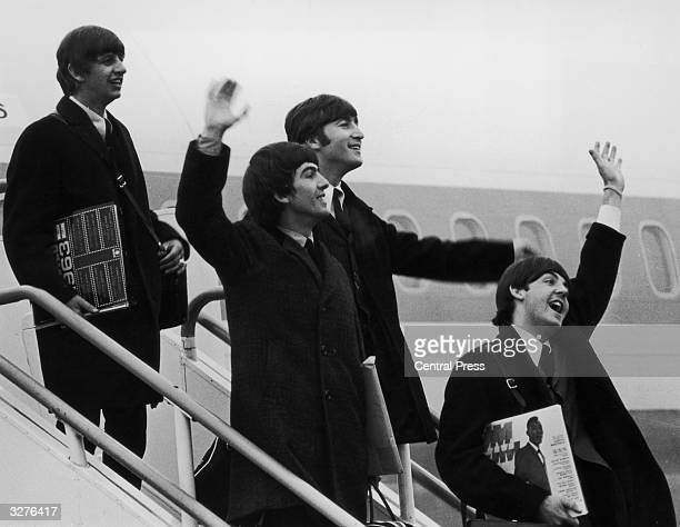 The Beatles left to right Ringo Starr George Harrison John Lennon and Paul McCartney step off the aeroplane which brought them back from their tour...