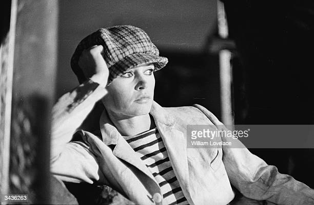 French actress Brigitte Bardot wearing a boy's cloth cap during the filming of Louis Malle's 'Viva Maria' in Mexico