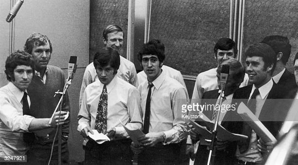 Part of the England soccer team record the World Cup song 'Back Home' at the Pye recording studio in London From left to right they are Alan Ball...