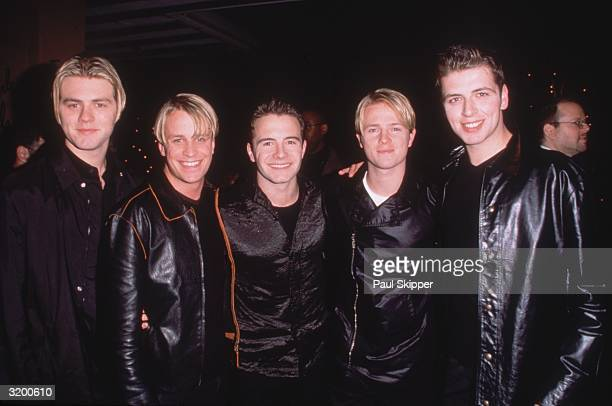 Irish pop group Westlife Bryan McFadden Kian Egan Shane Filans Nicky Byrne and Mark Feehily at the Arista Records preGrammy party Beverly Hills Hotel...