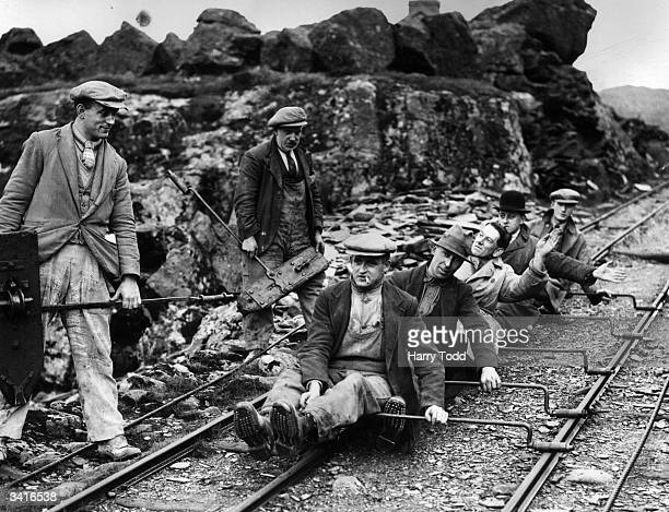 Workers at the CraigDdu slate quarries return home on specially constructed trolleys known as Cargwyllys saving the men a long walk home down the...