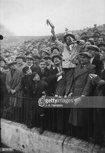 An enthusiastic young supporter at 'The Valley' ground of Charlton Athletic FC during the FA Cup tie match between Charlton Athletic and Leeds United