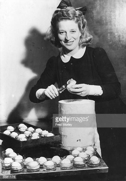 Elizabeth 'Dusty' Vickers prepares ice cream for the intervals at the Saville Theatre Although it is winter demand for ice cream is high following...