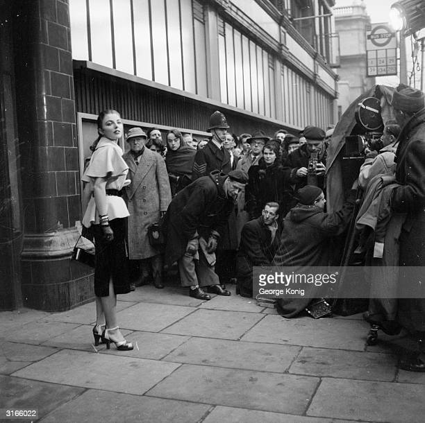 British starlet Joan Collins on location on the streets of London for the filming of 'Turn The Key Softly'