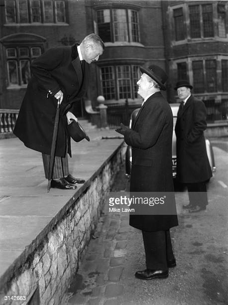 On the left Sir Henry Channon, Conservative MP talking to Peter Thorneycroft after a party meeting in Church House, Westminster at which Harold...