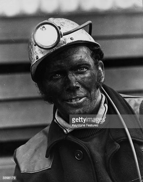 A Welsh miner after leaving a mine with his face covered in coal dust
