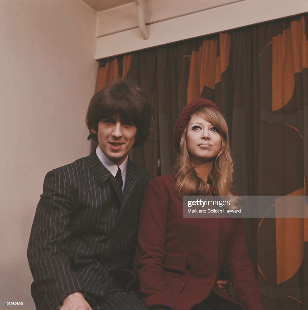 On the day after their wedding guitarist, singer and songwriter George Harrison (1943-2001) from The Beatles poses with his wife Patti Boyd at a press reception at NEMS in London on 22nd January 1966.