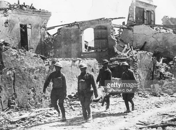 Four American soldiers carry a wounded soldier on a stretcher Vaux France