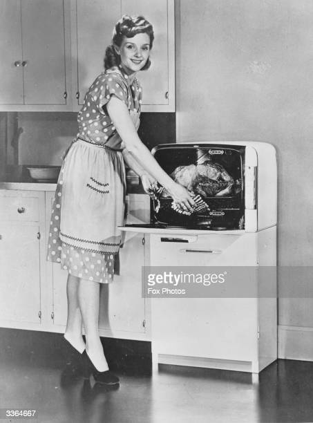 An American housewife with a new Bantam electric oven