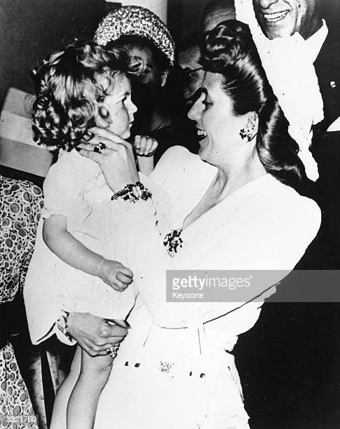 Eva Peron wife of the Argentine President makes friends with a little French girl on her arrival at the Hotel Ritz in Paris