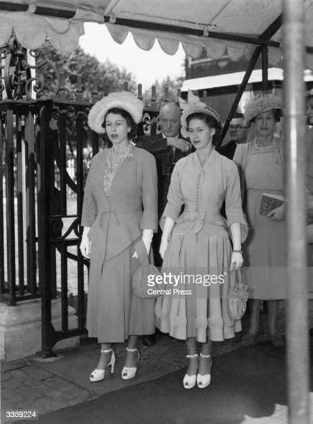 Princesses Elizabeth and Margaret Rose leaving the wedding of Lord Derby and Lady Isabel MillesLade