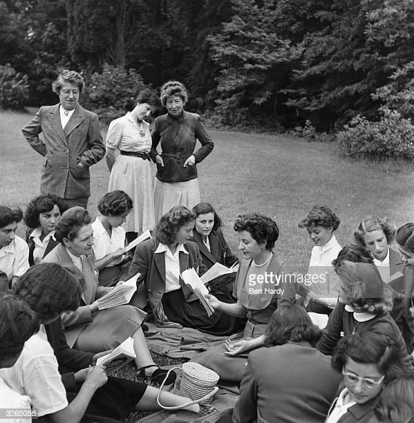 English writer Nancy Mitford discussing the translation of one of her books with pupils of the finishing school College Feminin de Bouffemont in...